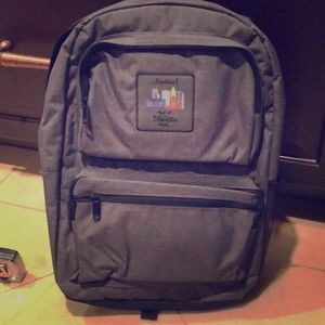 NEW. Backpack Grey lots of pockets